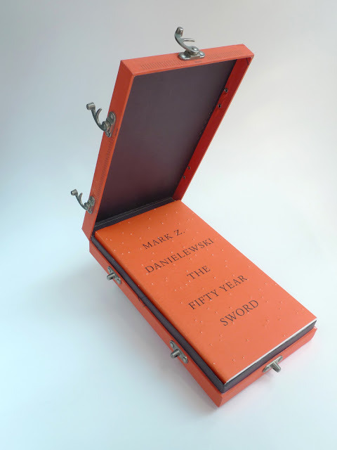 Image of the Day: The stunning collector's edition of Mark Z. Danielewski's The Fifty Year Sword, which features a deluxe slipcase with five metal latches, Nepalese binding (an exposed, specially stitched spine), and a signed frontispiece. Design by Peter Mendelsund.