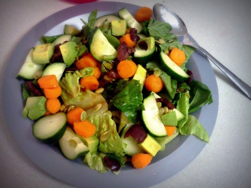 Delicious breakfast salad! :) Romaine, spinach, carrots, kalamata olives, avocado, pine nuts, pumpkin seeds, cucumber, and balsamic vinaigrette. Lots to do today so I should go to the gym right now!!