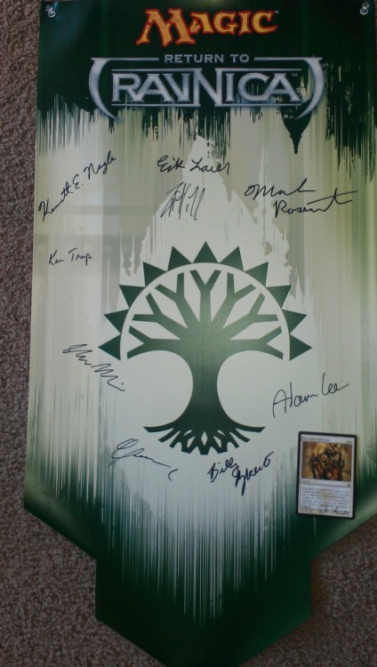 Selesnya banner with Rootborn Defenses, signed by WotC staffers sent to 'Bruce E'.