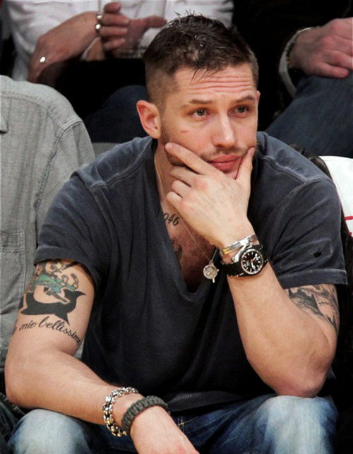 The way the haircut [in Lawless] for me came about was when Tom Hardy sent me a text message with HIS haircut and that was the end of that. As soon as I saw his haircut I cut my hair and then sent that picture to Jason and so on. This is how we made our decision. And then we showed up on set 'hey, Hillcoat, what do you think? There's no options left.'  Shia LaBeouf talks about the hair style of the Bondurants. I love that it was Tom who came up with the 'do - the one he had before they started filming Lawless (see photo). I love that Tom always puts such a lot of thought into his characters, with all the details - beard, haircut, cardigan, lesbianism…