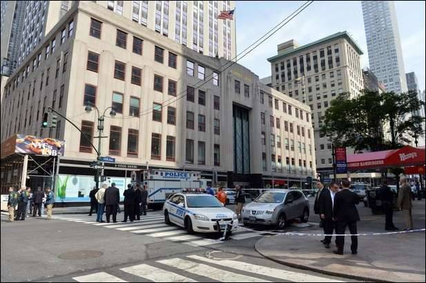 UPDATE:  Gunman kills former co-worker near Empire State Building; 9 injured in shootout with cops