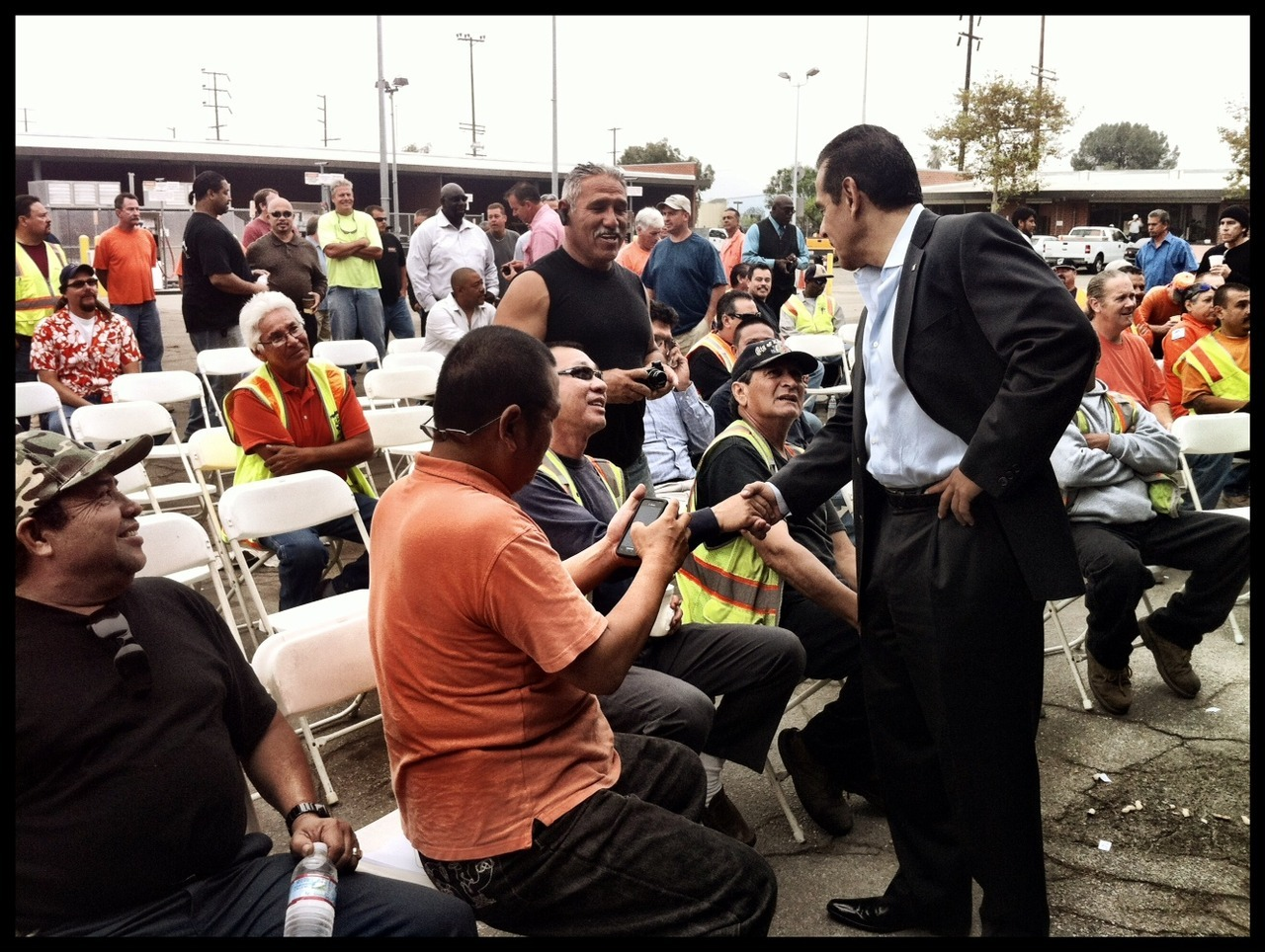 Mayor Villaraigosa joins the hard working men and women of the North Hollywood Bureau of Street Services. Last year we set a city record, paving or preserving 747 miles of LA roads! But there's more work to be done. Need a pothole filled in your community? You can report it here —> http://bit.ly/TXL1T6