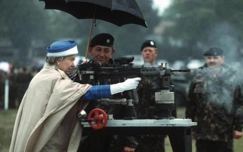 The Queen firing a rifle during a visit to the National Shooting Centre at Bisley, Surrey in 1993.
