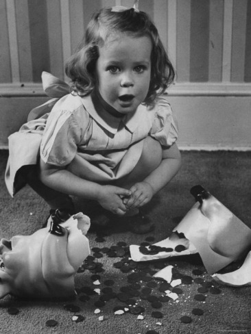 Little Girl and her Piggy Bank  Photo by Nina Leen c.1953