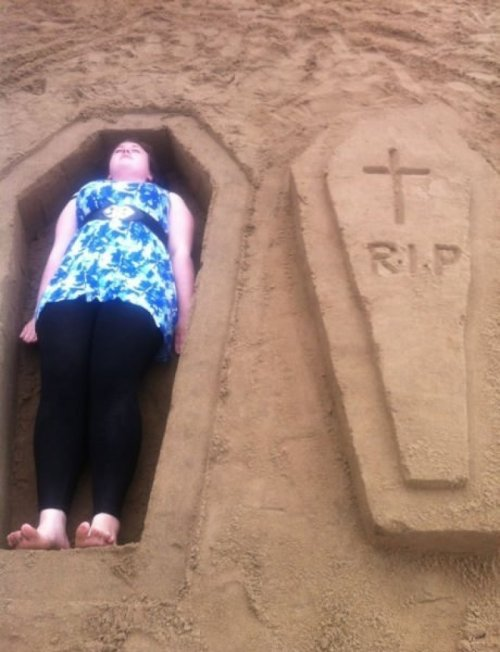 Sand Coffin This isn't what I meant when I said we should bury her in the sand.