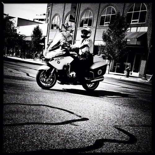 Cop #iphone #procamera #snapseed #noir #police #cop #motorcycle (Taken with Instagram at Campus Corner)