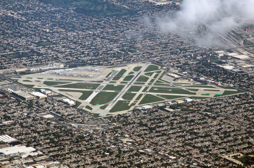 "uppiluften:  Midway Airport, ""The World's Busiest Square Mile."" [x]  As seen from the South, on approach to O'Hare."