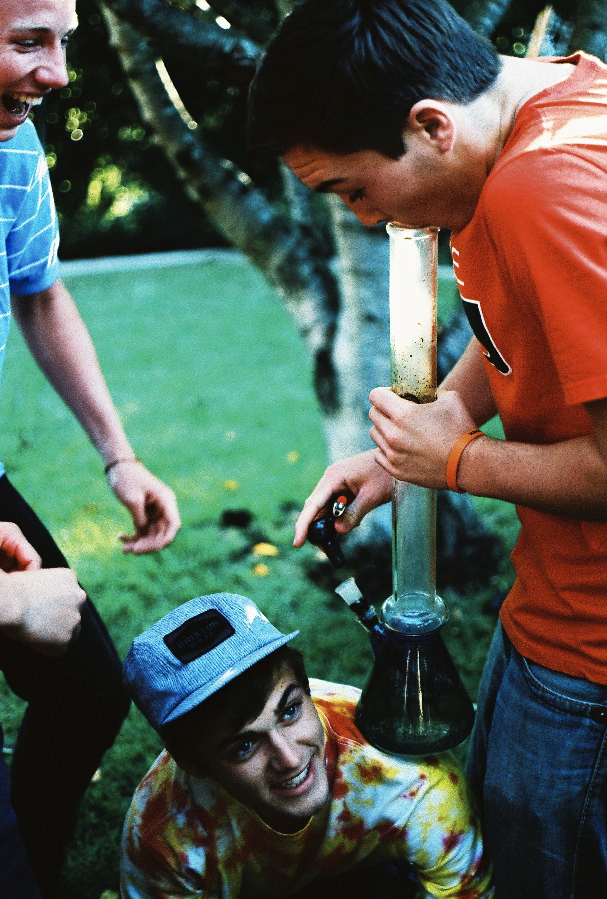 Kids smoking bong. Woooo! Good times!