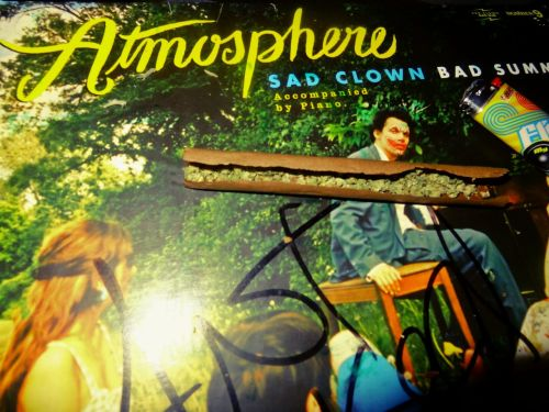 Rolling up the stress reliever on my Atmosphere vinyl.  About to go from a Sad Clown to a Toasted Clown.