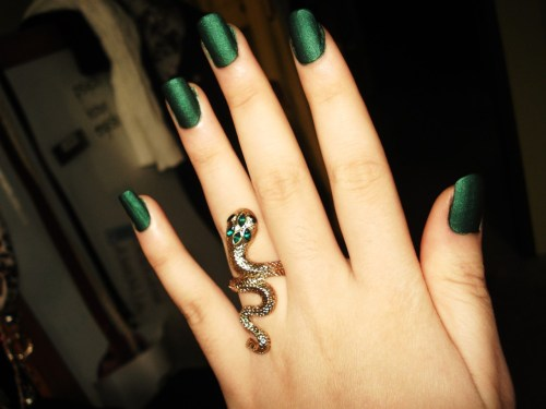 OPI green suede nail polish + Aldo snake ring.