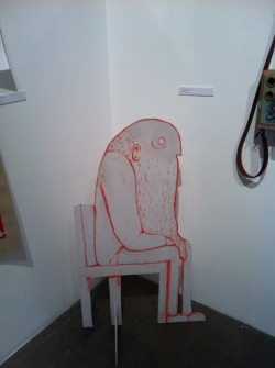 man in chair. also currently displayed in the art center student gallery.