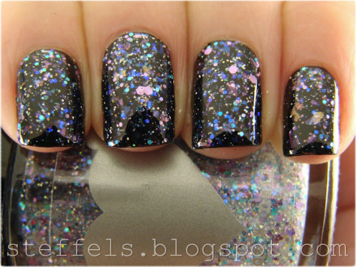 "Rainbow Honey ""The Worst Possible Thing"" over black — microglitter, iridescent glitter and lilac, turquoise and purple glitters make up this stunning topcoat (via steffels.: Rainbow Honey The Worst Possible Thing)"