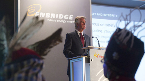 "Enbridge Inc. President and CEO Patrick Daniel speaks at his company's annual general meeting in Toronto in May as John Ridsdale, Chief Namoks, of the Wet'suwet'en First Nation, right, and Chief Martin Louie of Nadleh Whut'en nation, left, listen. (Nathan Denette/Canadian Press) ""Enbridge is the perfect example of a success story from lobbying,"" said Roger Harris, a former Liberal member of the B.C. legislature and former vice-president of aboriginal and community partnerships for Enbridge Northern Gateway Pipelines. (via Enbridge lobbying of Harper government a 'success story' - Politics - CBC News)  The federal registry shows 12 different lobbyists at work for the pipeline proponent in 2011 and 2012. A search of the five years prior to that, from the beginning of 2006 to the end of 2010, produces a list of 27 different lobbyists and 10 different consultant companies, including one representing the Clean Air Renewable Energy Coalition, comprised of Enbridge, Shell, ConocoPhillips Canada and a dozen other energy companies. Enbridge's proposal for a 1,700-kilometre pipeline that would deliver bitumen from the Alberta oil sands to a tanker port on the B.C. coast is incredibly complex, involving three government jurisdictions, 50 First Nations, an oft-maligned industry and a vocal public campaign against tanker traffic off the West Coast. ""I can't imagine a project that's more complex, yet it (Enbridge) was able to convince the federal government, the Conservatives, of its value to the point that the federal government, who puts in place the regulatory process by which projects are independently evaluated … (Enbridge) had them shamelessly out there supporting the project before their own process was even completed,"" Harris said. The Conservatives even changed the environmental regulations that affect the project, he said. ""If they don't like the outcome of that science, they can change it themselves, anyway,"" he said of the Conservative government."