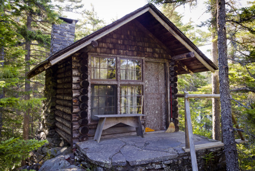 cabinporn:  Caretaker's cabin on Borestone Mountain, Maine.   From submitter Jere DeWaters:  The cabin, along with two large lodges and lots of other outbuildings is accessible only by boat after a rough ride or hike up the side of the mountain.  Imagine my surprise to find a full-sized Steinway grand piano in the main room —in tune, too.  The caretaker's cabin is just big enough for a single bed, writing desk, chair, and fireplace.  The door and window trim are made of spruce bark that has been peeled and soaked in the lake.  When it softens enough it is laid to dry flat and used for 'sprucing' up around the doors and windows, so to speak.        Sound like somewhere you'd like to spent a couple of days in solitude?  I can think of few things more appealing.