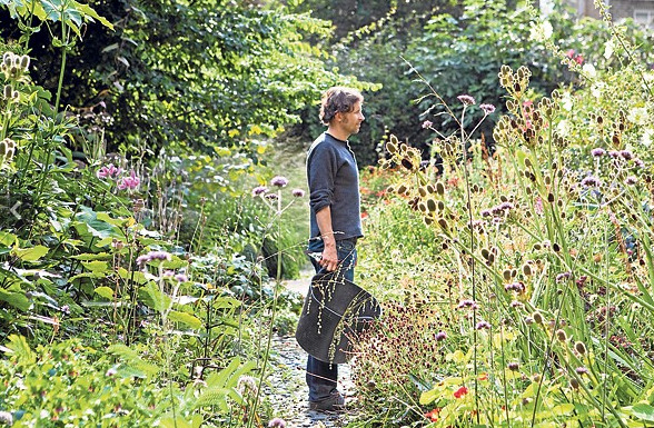 English garden designer, Dan Pearson, in his home garden in Peckham, London.