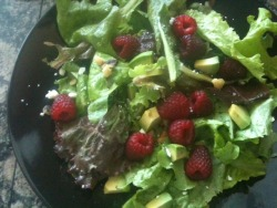 082412: Dinner, Part I: Salad!: farmers' market lettuce mix, raspberries, walnuts, feta crumbles, 1/8th of an avocado, home made balsamic fig vinaigrette.