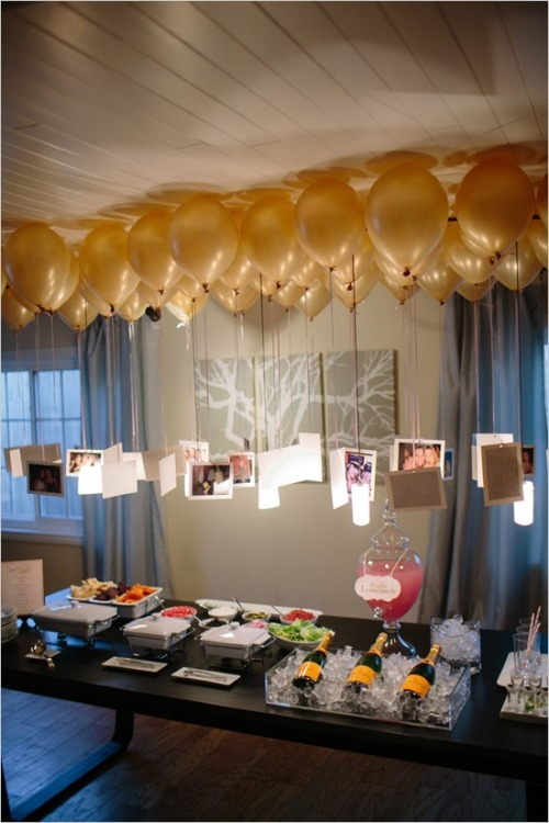 photojojo:  We love the idea of using balloons as floating hangers for photos! The above was for a wedding, but thanks to the hundreds of different colored balloons, you can adapt this for just about any occasion!  Use Balloons as Floating Hangers for Memorable Photos! via Pinterest  This is such an amazing idea! It'd need to be over a table or something, though, so the taller people don't get all tangled up!
