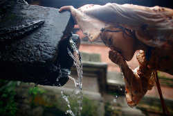 Anjana Lama drinks water from a stone spout in Lalitpur, Nepal.  Photograph: Navesh Chitrakar