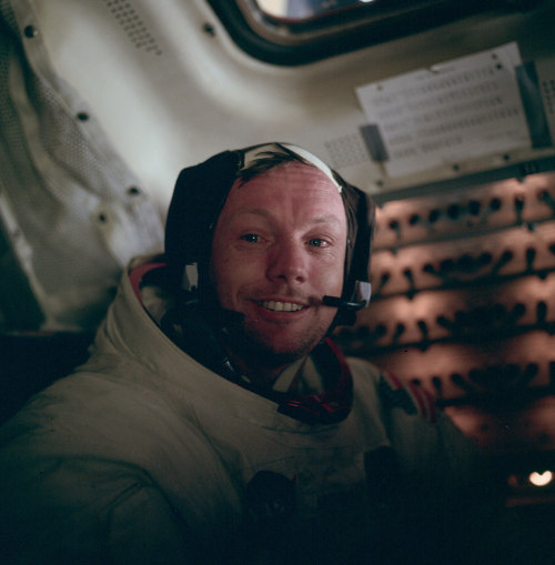 Neil Armstrong in the cabin of the lunar module after the completion of the EVA (aka, the moonwalk.)July 21, 1969 Photograph by Buzz Aldrin [nasa / AS11-37-5528]