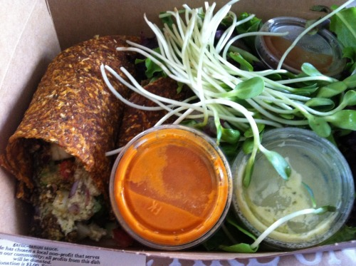 fernwah:  rawveganeattoslim:  I AM HAPPY: Falafels, zucchini humus, on Sundried tomato bread. I added avocado. The bread/wrap is excellent. There is a huge salad under the contained sauces.  dsphpadmn  Nom Nom