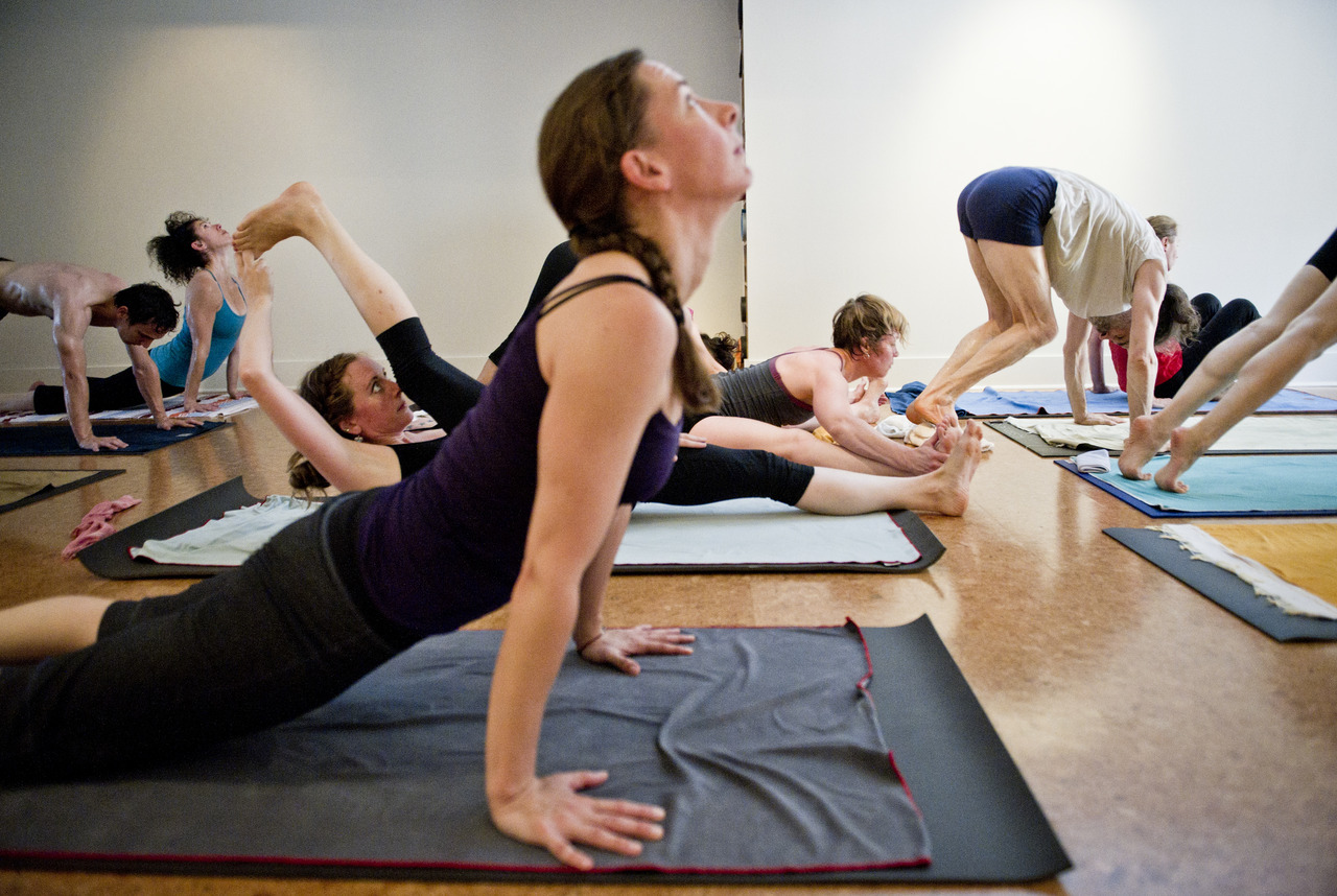 1. Robert Stadler winds down during the mysore yoga class at the Ashtanga Yoga Centre on Yonge Street, July 5, 2012. Students practice at their own pace and receive one-on-one help from instructors. (Galit Rodan/The Globe and Mail) 2. Students in the mysore yoga class at the Ashtanga Yoga Centre on Yonge Street practice at their own pace and receive one-on-one help from instructors, July 5, 2012. (Galit Rodan/The Globe and Mail) 3. Camille Greenstein (left), Simone Levine and Jessa Bissett perform a variety of poses in the mysore yoga class at the Ashtanga Yoga Centre on Yonge Street, July 5, 2012. The students practice at their own pace and receive one-on-one help from instructors. (Galit Rodan/The Globe and Mail) 4. Instructor Lisa Novembre helps Janine Poon with a pose while Tanya Hammond goes through her routine during the mysore yoga class at the Ashtanga Yoga Centre on Yonge Street, July 5, 2012. Students practice at their own pace and receive one-on-one help from instructors. (Galit Rodan/The Globe and Mail) 5. Students in the mysore yoga class at the Ashtanga Yoga Centre on Yonge Street practice at their own pace and receive one-on-one help from instructors, July 5, 2012. (Galit Rodan/The Globe and Mail) 6. Students in the mysore yoga class at the Ashtanga Yoga Centre on Yonge Street practice at their own pace and receive one-on-one help from instructors, July 5, 2012. (Galit Rodan/The Globe and Mail) 7. Instructor and studio owner David Robson leads the class in a prayer, July 5, 2012. (Galit Rodan/The Globe and Mail) 8. Jessa Bissett stretches during the mysore yoga class at the Ashtanga Yoga Centre on Yonge Street, July 5, 2012. Students practice at their own pace and receive one-on-one help from instructors. (Galit Rodan/The Globe and Mail) 9. Students in the mysore yoga class at the Ashtanga Yoga Centre on Yonge Street practice at their own pace and receive one-on-one help from instructors, July 5, 2012. (Galit Rodan/The Globe and Mail) 10. Vince Smit practices mysore yoga at the Ashtanga Yoga Centre on Yonge Street, , July 5, 2012. The students practice at their own pace and receive one-on-one help from instructors. (Galit Rodan/The Globe and Mail) link:  http://www.theglobeandmail.com/life/health-and-fitness/fitness/for-this-yoga-class-a-certain-level-of-brave-is-required/article4395072/