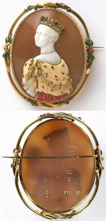 """ Brooch with cameo of Queen Victoria, by Félix Dafrique; cameo by Paul Lebas (active 1829-70)  Brooch with cameo of Queen Victoria (front above, back below)By Félix Dafrique; cameo by Paul Lebas (active 1829-70)ParisDated 1851Shell, gold, enamel, emeralds and diamondsMuseum no. M.340-1977 This brooch was shown at the Great Exhibition in London in 1851, perhaps to attract the queen's attention during one of her many visits to the exhibition. The image was taken from a portrait that showed the queen in Garter robes. The Parisian jeweller Félix Dafrique revived a Renaissance style of jewel called 'commesso' (meaning 'joined'). The cameo was cut by Paul Lebas, a well-regarded sculptor and gem engraver, who often exhibited at the Paris Salon. His most prominent works included cameo portraits of the French royal family. The brooch was shown at the Great Exhibition, where over 6 million visitors viewed more than 13,000 exhibits. In carving the cameo, Lebas probably followed this engraving. The original portrait shows the queen facing the other way, but the engraving is in reverse. Sully was a society portraitist from Philadelphia. On a visit to London in 1837 he was commissioned to paint a portrait of the new queen. He was delighted with her 'sweet tone of voice, and gentle manner'. She, in turn, was pleased with the portrait, which highlighted her best features: her shoulders and the curving line of her neck."""