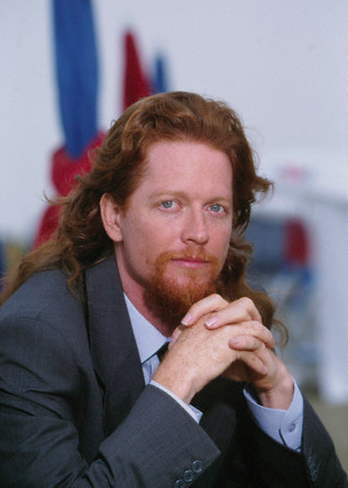 We're back from our summer vacation with Eric Stoltz week! Enjoy these flashbacks of the thinking woman's indie sex symbol. Here he is, in a pensive mood and sporting a captivating pompadour/mullet/goatee combo, at the 1994 Deauville film festival.
