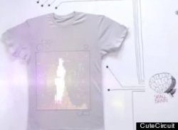 techspotlight:  TshirtOS: 'Wearable, Shareable' Computer Demoed On London's Streets (VIDEO) A t-shirt which allows the wearer to share their Facebook status, Tweets, photos and songs with anyone who walks past has been demoed on the streets of London. 'T-Shirt OS' is literally a wearable garment with its own operating system. It comes with a camera to take photos, a headphone jack to listen to iTunes tracks, and several other functions controlled via a mobile app. It has 1024 LED lights on a 32x32 grid, and can display a full range of colours. The camera is an Omnivision Camera Cube, with a footprint of mere millimetres, and it also has a three-axis accelerometer, which can detect when the wearer jumps or moves at speed. It also includes Bluetooth, and its own circuit board and processors. The t-shirt was previously shown online to wild acclaim, and in a new video is seen working for the first time around the streets of London.