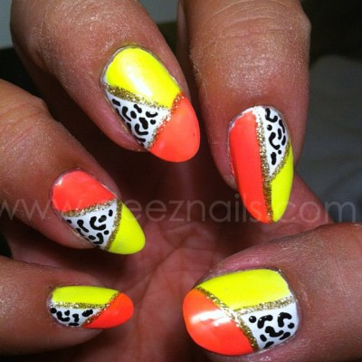 my 3 favorite things: neon, gold, and animal print.. #deeznails #nails #nailart #nailswag #nailpolish #nailporn  (Taken with Instagram)