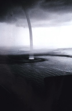 museumuesum:  Steve Nicklas, NOS, NGS A giant waterspout in the mature stage. During peak intensity this waterspout had a diameter of approximately 30 meters. Florida Keys, Florida, 1969 September 10 scanned black and white negative