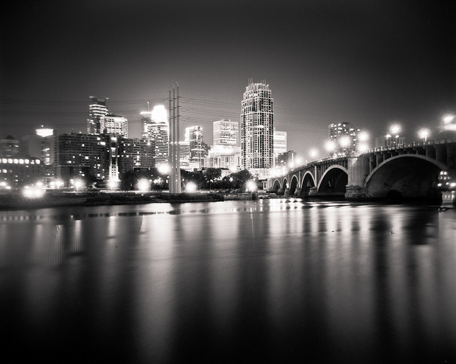 Dreamy, Plastic Minneapolis on Flickr.Holga 120N | Fuji Acros 100 | Rodinal (1:100) | Post in LR3 It's fun to revisit and photograph places. You get to see what time does to a place. I haven't been doing this long enough to notice any real changes in the Minneapolis skyline, but my previous photographs of the skyline from St. Anthony Main have all been very different than this last one. I love how the dreaminess of the plastic Holga lens combined with the long exposure softens this malleable scene. I only wish that the lightning that was surrounding me showed up in the background. Oh well, I'm sure I'll be back here with a new setup and a fresh perspecive.