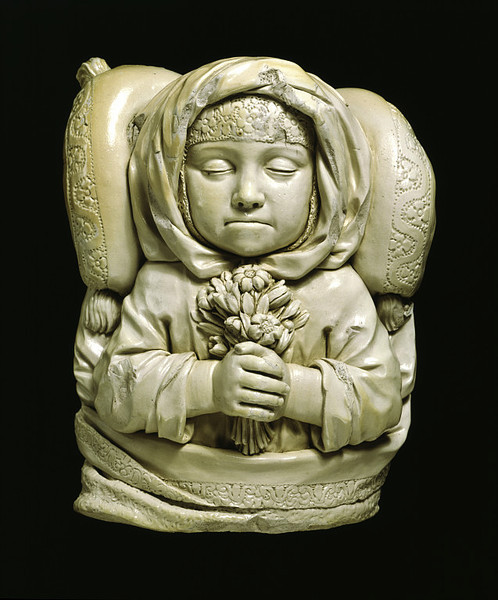 Lydia Dwight Dead; made by John Dwight's Fulham Pottery; England; 1674. Source: V&A Museum.  One of the earliest experiments in European ceramic sculpture, this object was commissioned by the father of the dead child in order to capture her likeness and perpetuate her memory. It was a personal and private sculpture, reflecting the grief of the little girl's family, and perhaps not intended for open display in the house. […] Lydia Dwight was six years old when she died on 3 March 1674 (1673 by the Old Calendar). The fact that the next daughter was also christened Lydia does not suggest lack of grief on the part of the parents, but was usual practice in an age noted for its high infant mortality.