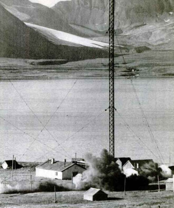 "vleugl:  The radio mast at Spitsbergen being blown up by Royal Engineers - false weather reports sent while the raid was under way kept German reconnaissance planes away. On 25th August 1941 a force of British, Canadian and Norwegian soldiers landed on the Norwegian island of Spitsbergen. The unopposed raid was intended to deny the coal and port facilities to the Germans. Mary Olsen lived on Spitsbergen with her daughter Marie and husband Andor who worked in the coal mines. She later told the British press how she learnt that the British were going to blow the place up and evacuate them to Britain: Warm sunshine bathed the little Arctic town where we lived. I was at work in my timber-built cottage, my daughter Marie was playing outside with our pet ""husky"" dog Kiki. Suddenly a neighbour cried out, ""There are warships in the bay!"" I took Marie by the hand and we ran to the sea, Kiki galloping at our heels. The lifting mist revealed a great fleet of ships at the entrance to the fiord. Ship's boats packed with soldiers were coming towards the quay. As the first boat scraped alongside an officer in uniform sprang ashore. ""Good-morning"", he called in Norwegian. No one in the little knot of people, mostly women and children, who had gathered to watch, answered him. We did not know who they were. We were suspicious. Soldiers in khaki climbed out of the boat – smiling soldiers who stood smartly to attention and winked at the children clinging to our hands. Then someone noticed the flag of Norway on the officer's shoulder. There was an audible sigh of relief. It was all right. These were British soldiers – not Germans. Spitzbergen was being occupied. I listened uncomprehendingly to my English-speaking countrymen who were now chatting with the newcomers. I watched, wondering, until Marie suddenly said that she was hungry. We went back home. Then an excited friend told me ""The Canadians have come to take us away. They are going to free our beloved Norway."" The news was a shock. I love my home. Andor my husband, is a foreman in the mines. All our life was here. This was a big decision. Sad thoughts ran through my mind. ""This is my dear Spitzbergen. This is our home. Andor and I have a beautiful home and a beautiful child. Oh God, why should there be Nazis…"""