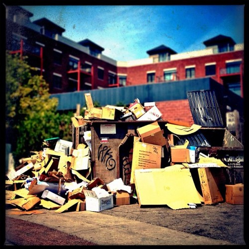 Welcome back students (there's a dumpster under there somewhere…) #iphone #procamera #snapseed #biglens #lomob #garbage (Taken with Instagram at Five Guys Burgers and Fries)