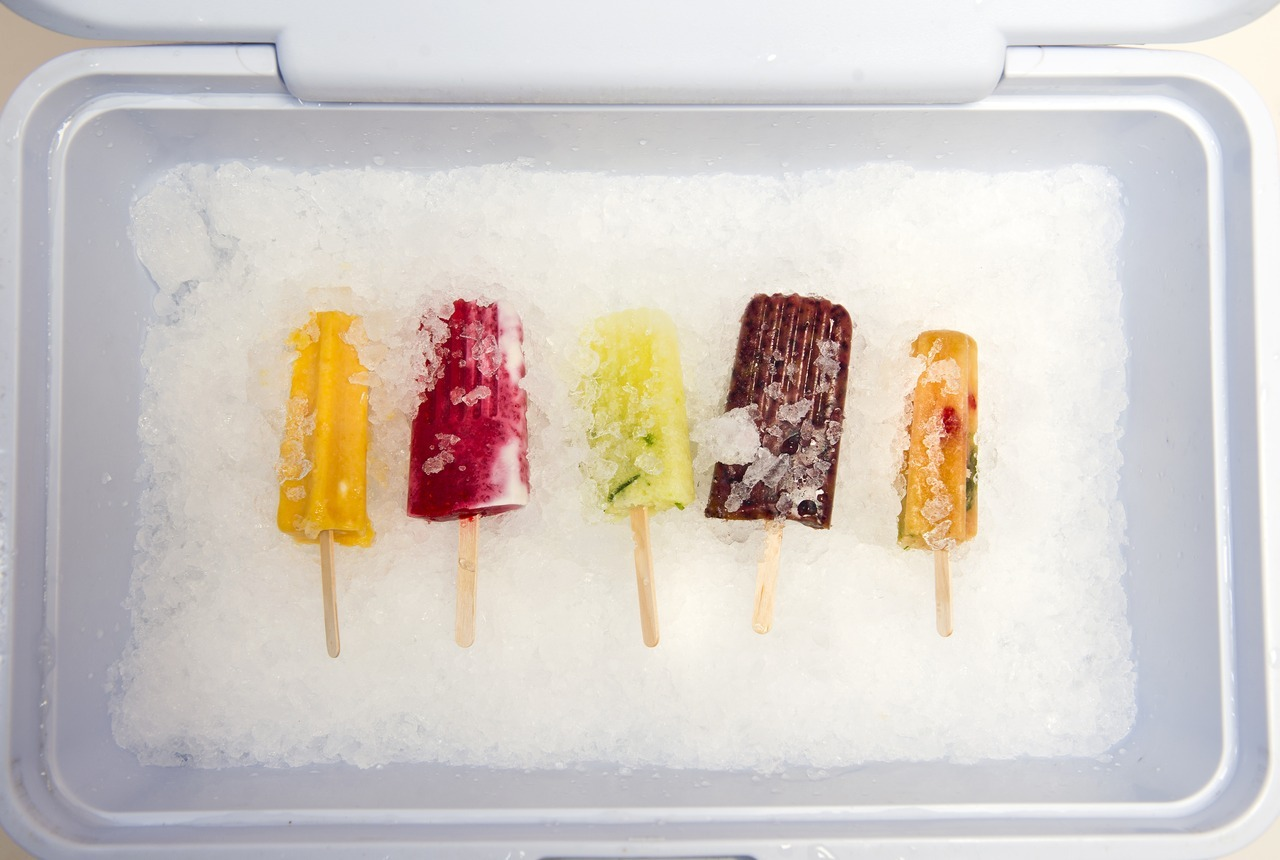 Shooting popsicles is a lot harder than one would think… For one thing, your subjects are in perpetual danger of melting away on you. Studio-type stuff is not one of my biggest strengths as a photographer so there was a lot of pre-shoot practicing with regular old popsicles.  I knew the Globe wanted something clean - a white background or the popsicles on ice. As far as the ice went, the main challenge for me was figuring out how to light the popsicles well without blowing out the details on the ice.  I knew they wanted to feature the photo pretty prominently, which I think kicked my perfectionism into overdrive. I've found over the course of the summer that I'm often harder on myself than my editors are.  Chris Nuttall-Smith, who made the popsicles and wrote the piece for the Globe, was equally picky. We kept at it for a couple hours until we had something we were both happy with and we felt would really make readers want to try these puppies.  Best part - I got to try ALL the popsicles. And they were incredible. Hands down the best popsicles I've ever had.  1. Left to right: Roasted plum, tarragon and yogurt swirl; raspberry and cream; cucumber, elderflower and tequila; blueberry and cardamom; and Pimm's cup popsicles for grown-ups made by Chris Nuttall-Smith, July 19, 2012.  (Galit Rodan/The Globe and Mail) link: http://www.theglobeandmail.com/life/food-and-wine/food-trends/boozy-and-delicious-try-these-grown-up-popsicles/article4439357/