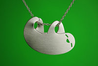 [A silver or steel pendant of a sloth.]