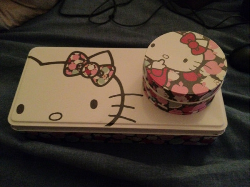 They're Liberty of London Hello Kitty jewelry tins I brought like a couple of months ago. I was happy with them until I found a nice jewelry box from The Container Store that was much bigger so they became obsolete just like that. I'm giving two of them away (see pictured) to a friend who can give them more love than me (although I am keeping one for a tin I can take on my vacations and the like). But I love this Apple Tree pattern so much (and you can clearly see, lol).
