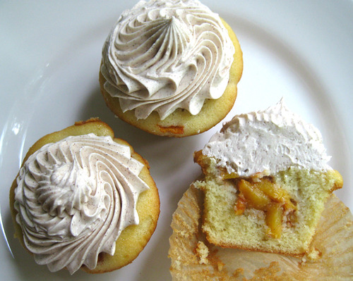 bakeddd:  peach cobbler cupcakes with cinnamon buttercream click here for recipe