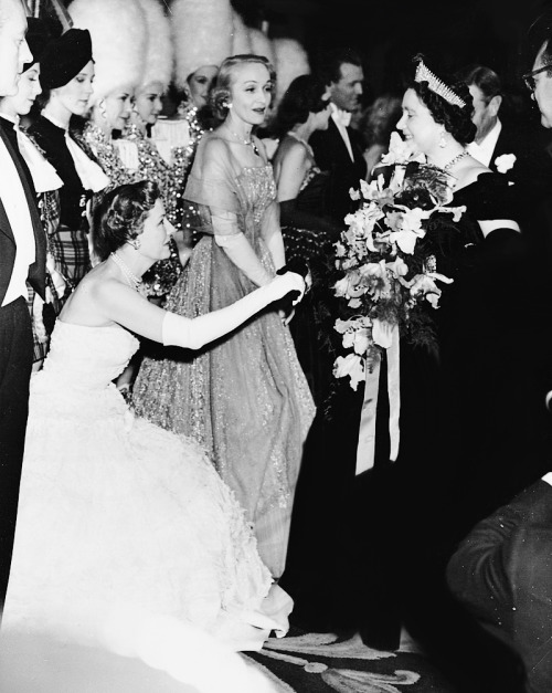 Irene Dunne is presented to Her Majesty the Queen after the Royal Command showing of The Mudlark. Marlene Dietrich is on the right. October 31, 1950