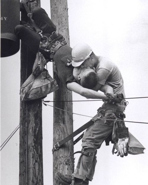 "collectivehistory:  ""Kiss of Life"", 1968 Pulitzer Prize A utility worker, J.D. Thompson, is suspended on a utility pole and giving mouth to mouth resuscitation to a fellow lineman, Randall G. Champion, who was unconscious and hanging upside down after contacting a high voltage line. Champion survived and lived until 2002, when he died of heart failure at the age of 64. Thompson is still living.  Rocco Morabito"