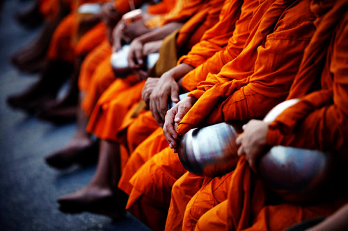 Buddhist monks attend an alms offering ceremony.
