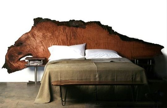 Gnarled wood slab headboard.