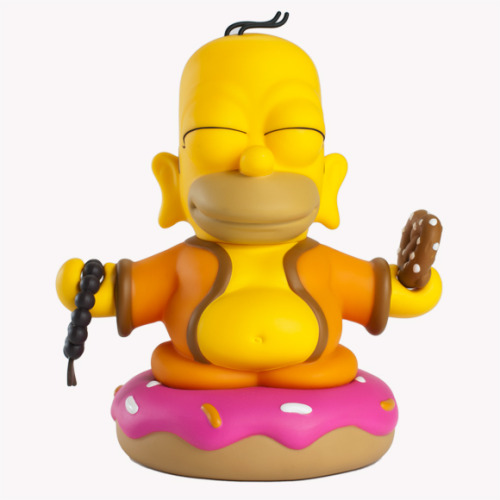 "Homer Buddha, ""Mmmmm.  Enlightenment."" The kidrobot x the Simpsons toy collaboration continues with the new 7-inch vinyl Homer Buddha. This standalone, zen-like Homer inspired by ""Goo Goo Gai Pan"" (Season 16, Episode 12), comes packaged in a white and red box parodying a Chinese take-out food container.  ""With a pretzel in one hand, and beads in another, Homer passes down the oral tradition of donut eating…"" —kidrobot blog  Homer Buddha, peacefully sitting on top of ""giant fried dough topped with pink frosting and rainbow jimmies,"" will be available starting September 6th, 2012."
