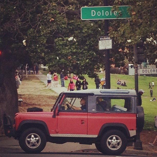 #park #trees #wiwt #suv #cars #landrover #defender #soloparking #streetsign #photooftheday #ig #igerssf #iphone4s #love #life #sf #people #streetstyle #dolores #picoftheday I want one 😍 (Taken with Instagram)