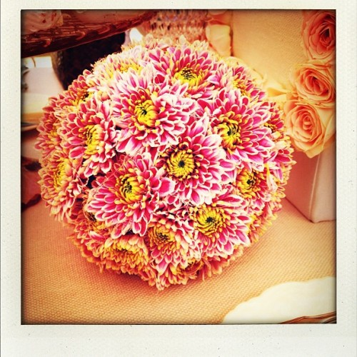 "Happy Monday! This is the cutest flower ""arrangement"" I've ever seen: a ""ball"" of flowers! #silverlining  (Taken with Instagram)"