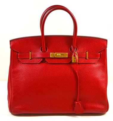 Go Rouge! Break up any monochromatic look with this vivacious red. The Togo leather's texture is rich and ultra luxe.
