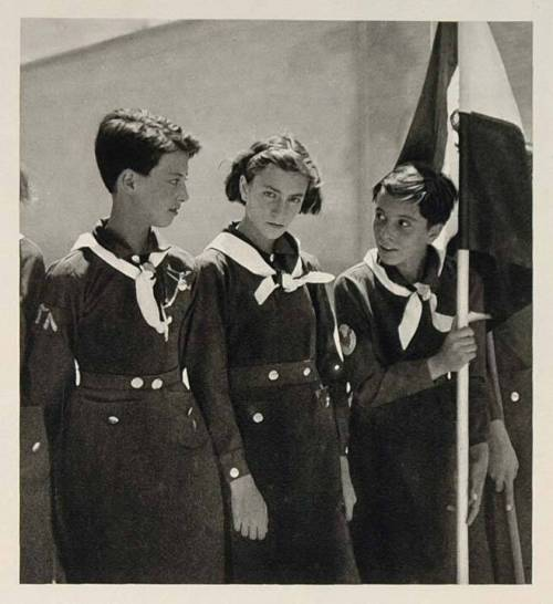 farsizaban:  Young Iranian Girl Scouts prepare for parade in their uniforms. (Circa 1940's-1950's)