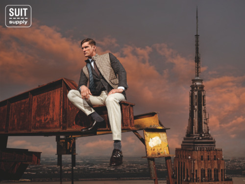 "suitsupply:  Introducing Suitsupply Fall/Winter 2012 To highlight the opening of Suitsupply's third store in the U.S. and the upcoming expansion planned across America, the brand's Fall/Winter 2012 campaign was inspired by The Roaring Twenties. Lead designer Murray Coetzee names The Great Gatsby as a major source of inspiration for the collection, which features shades of steel and rust with a focus on three-piece suits and two new double-breasted models. House photographer, Carli Hermès, shot images harkening back to the Mohawk Iron workers who built the iconic landmarks found across the New York City skyline. The ""building"" energy of this period is visualized through a modern adaptation of the famed Lunch on a Crossbeam. The images depict Suitsupply's dapperly dressed men towering above the metropolitan just like those original workers. The Washington D.C. store is set to launch August 30th, following the opening of the SoHo loft in 2011 and Chicago penthouse earlier this summer."