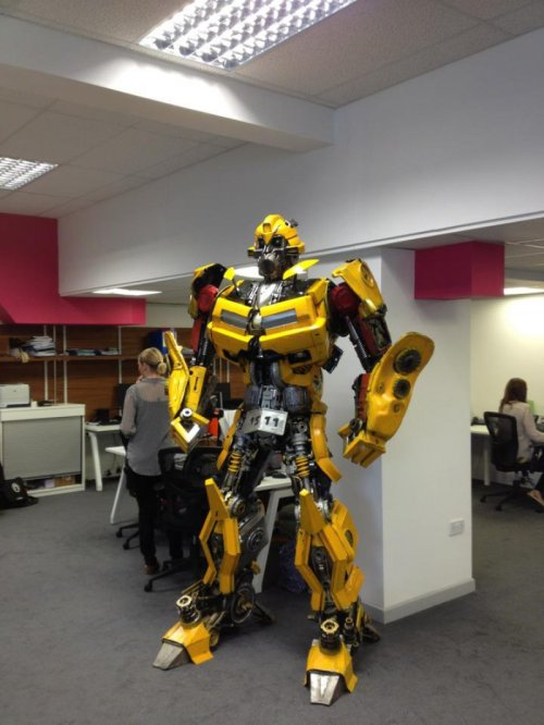 collegehumor:  Transformer Statue Made of Car Parts It really ties the room together.