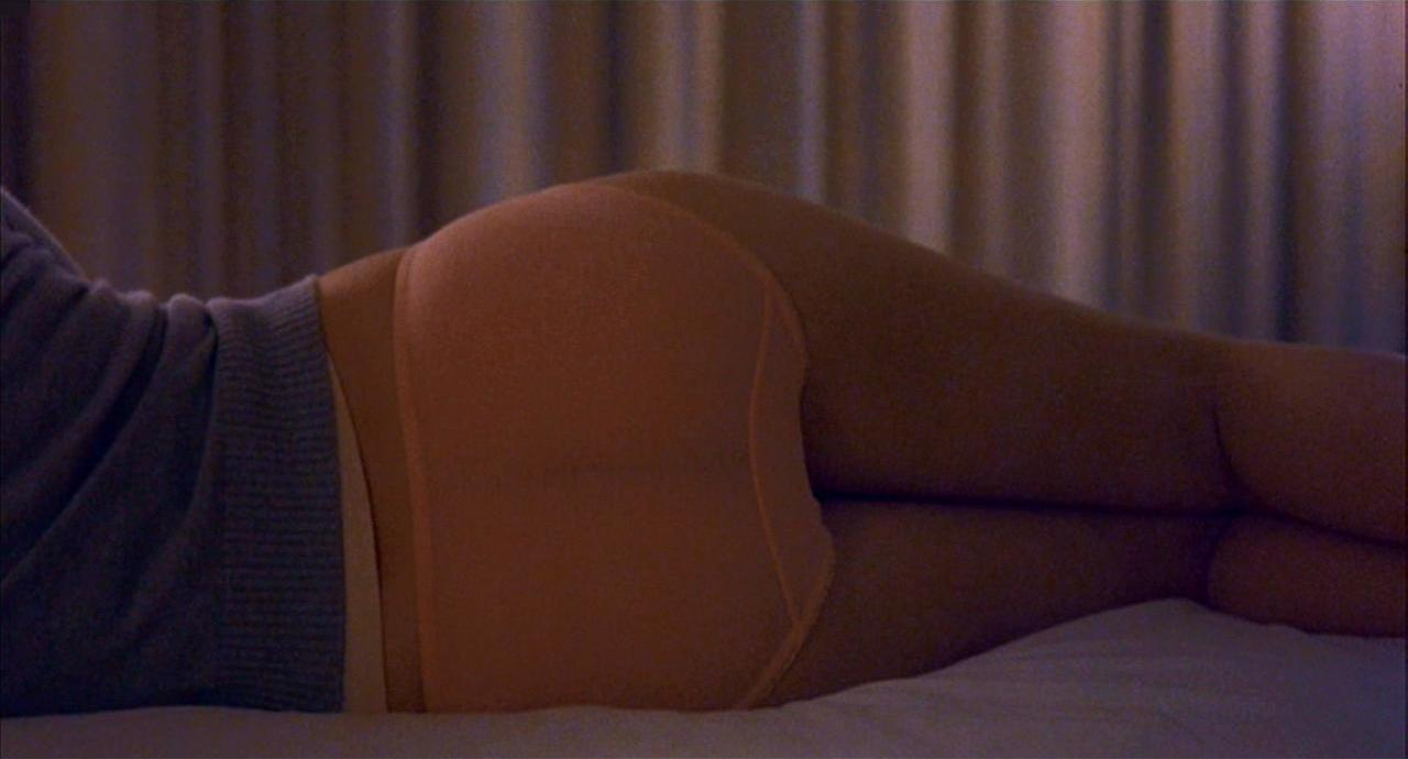 "reverse-shot:  The cinema is home to any number of legendary asses: Bardot, Balthazar, Brett Ratner … and that's just a sample of the Bs. Filmmakers have used them to a wide variety of ends, most often to tease, tempt, or titillate, but Sofia Coppola uses Scarlett Johansson's as a cry for help. Her script begins: ""The back of a GIRL in pink underwear, she leans at a big window, looking out over Tokyo."" The writing is lucid and spare, but the image, as it appears in the finished film, offers even less information—most critically, the curtain on that big window is pulled closed. The unmistakable sight of Tokyo blinking in the distance might have normalized the frame, deflating the image of its mystery and reducing its components to their most blunt interpretations—that's Tokyo, that's a crisp hotel bed, that's a privileged white ass. Effectively, surrounding that totemic butt with detail would have solved it, which is a tactic counter to the film's most basic approach to the inner lives of its characters and the rare beauty of the connection they share. But Coppola opts for obfuscation—the girl could be anywhere, but to know her is to learn why she isn't."
